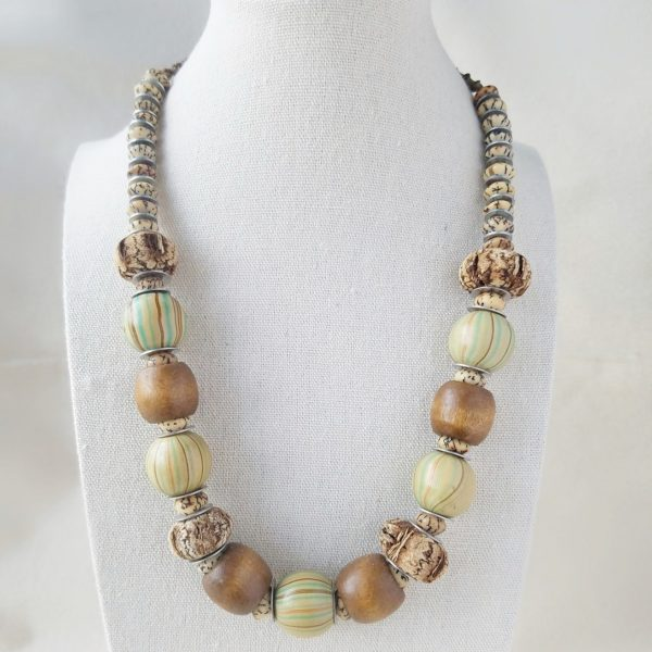 natural wood beaded necklace in blue green and brown, macrame details